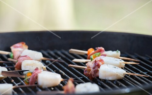 Scallop skewers on a barbecue