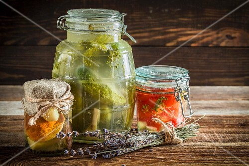 Pickled cucumbers, tomatoes and mushrooms in jars