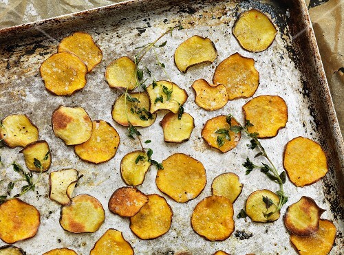 Sweet potato crisps on a baking tray