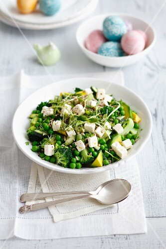 Broccoli and avocado salad with cucumber, peas, feta cheese and bean sprouts for Easter