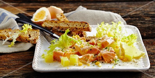 Char salad with potatoes and frisee lettuce