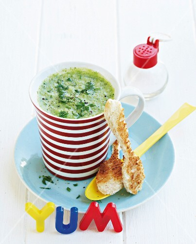 Broccoli soup with Cheddar cheese and toast spoons
