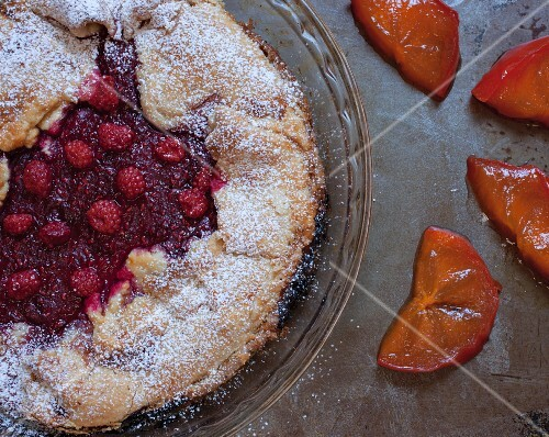 Rustic wild raspberry and persimmon tart (seen from above)