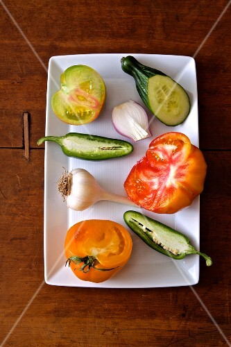 Fresh heirloom tomatoes, cucumber, jalapeño peppers, garlic and onions