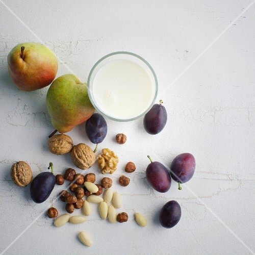 Nuts, pears, damsons and a glass of milk