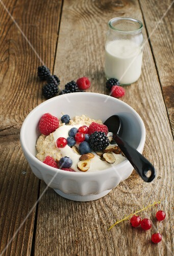 Porridge with wheat germ, berries and hazelnuts