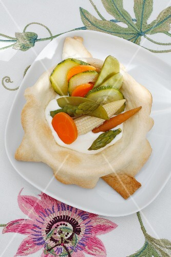 Steamed vegetables with yoghurt and a mint sauce in a pasty dish