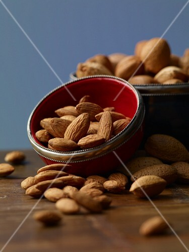 Almonds in a bowl on a wooden table