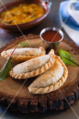 Beef empanadas (South American pasties) served with tomato relish