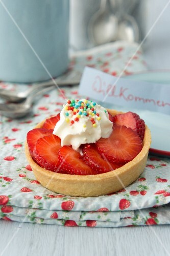 Strawberry tartlet with colourful sugar sprinkles