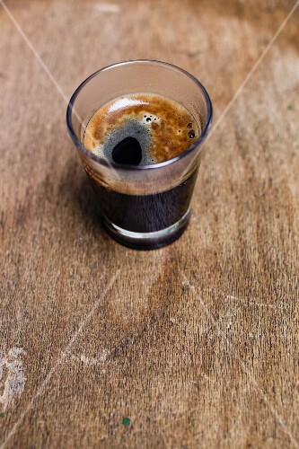 A glass of black coffee
