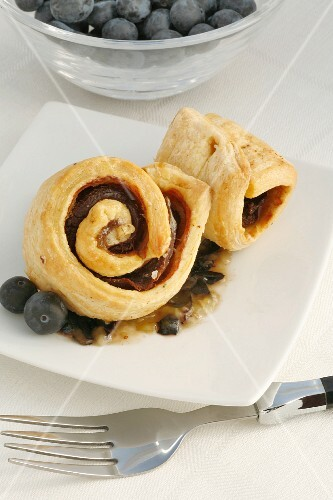 Pork fillet wrapped in puff pastry with blueberries