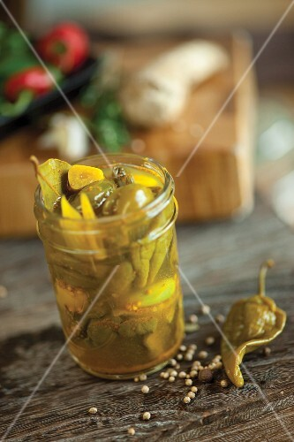 Pickled chilli peppers in a preserving jar