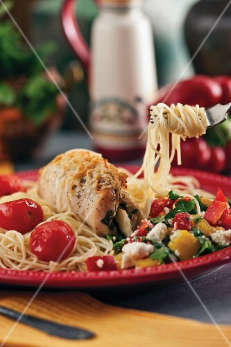 Stuffed turkey roulade on pasta with vegetables