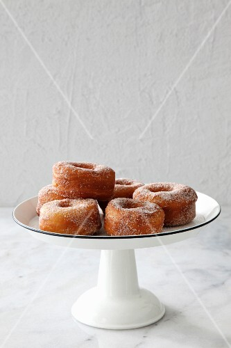 Doughnuts with sugar and cinnamon on a cake stand