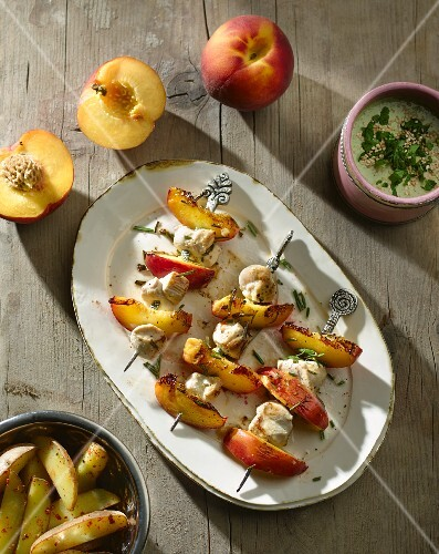 Chicken and peach skewers with a sesame seed and herb sauce
