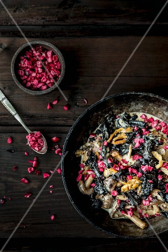 Mixed mushrooms in a creamy sauce with chopped cranberries