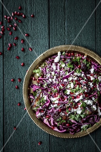 Red cabbage salad with feta cheese, parsley and pomegranate seeds