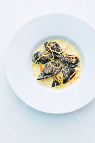 Black mussel ravioli in a saffron and curry sauce