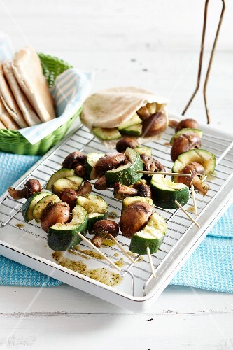 Grilled vegetable and mushroom skewers with pita bread