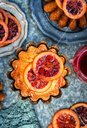 Syrup cakes with candid blood oranges