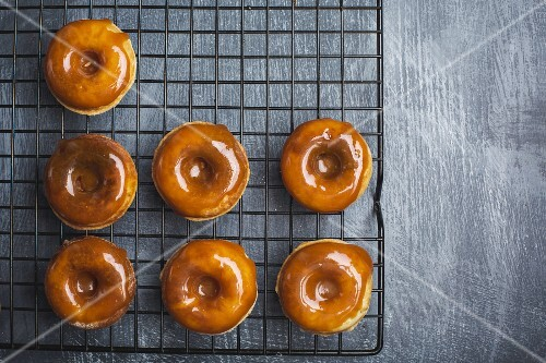 Doughnuts with salted caramel glaze on a wire rack