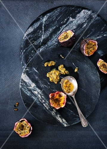 Passion fruit on two marble platters