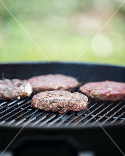 Lean beef burgers on a barbecue