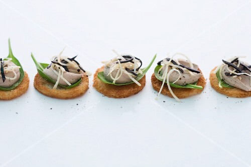 Crostini topped with duck liver mousse, celeriac and truffles