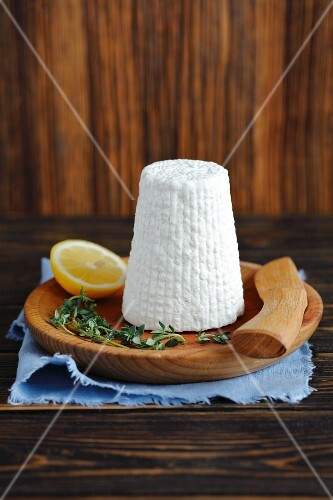 Ricotta cheese on a wooden plate