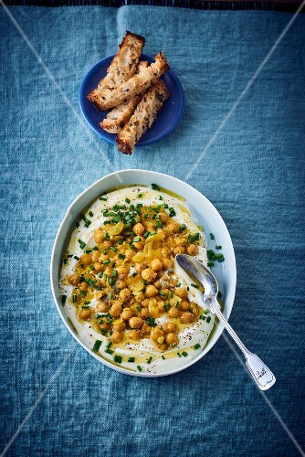 Feta cheese cream with chickpeas and chives