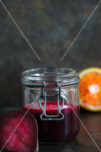 Beetroot juice with blood orange in a flip-top jar