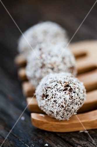 Coconut truffles on a wooden fork