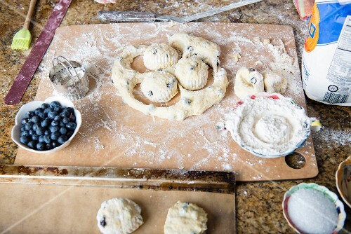 Blueberry scones being made: dough balls being cut out