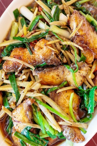 Stir-fried fish with ginger, pepper and vegetables