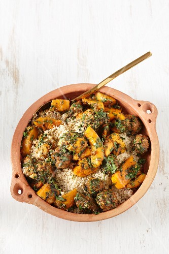 Meatballs with vegetables on a bed of couscous