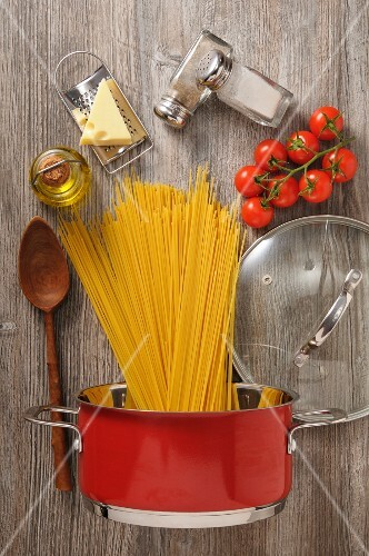 Ingredients and cooking utensils for a pasta dish (seen from above)