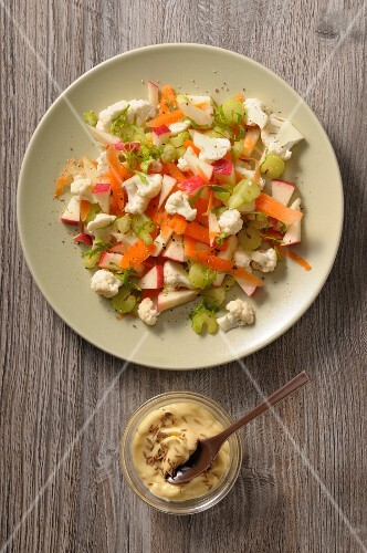 Cauliflower salad with apple, celery and carrots