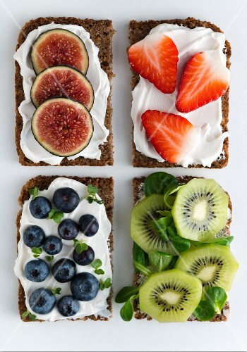 Open wholemeal sandwiches topped with soya quark and various fruit