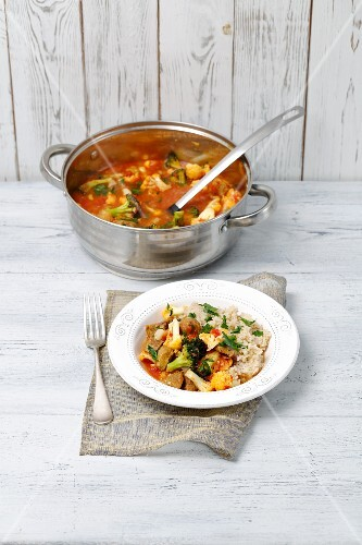 Pork stew with vegetables served with pearl barley
