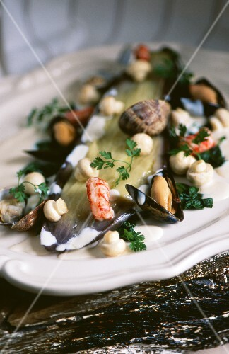 Aubergines with seafood and mushrooms