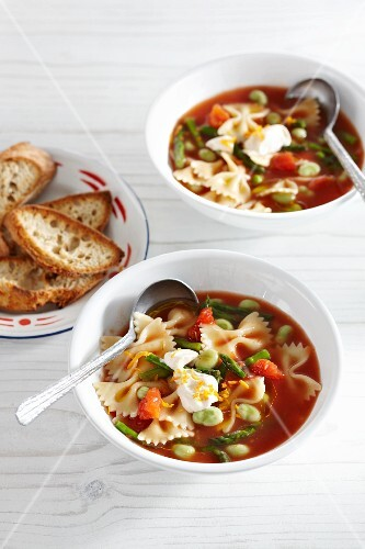 Tomato soup with spring vegetables and farfalle pasta