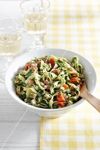 Tagliatelle with fresh herb pesto, tomatoes and diced ham