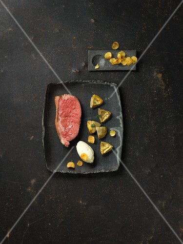 Aqua-aged beef with roasted artichoke hearts and potato ice cream