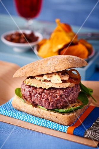 A rossini burger with vegetable crisps