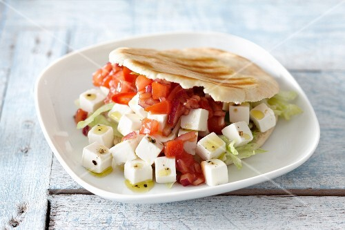 Pita bread with feta cheese, tomatoes and lettuce