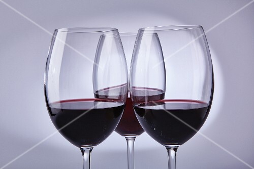 Red wine in three glasses
