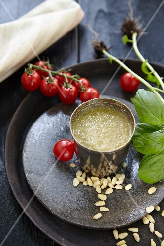 A fresh tomato drink with pine nuts and basil