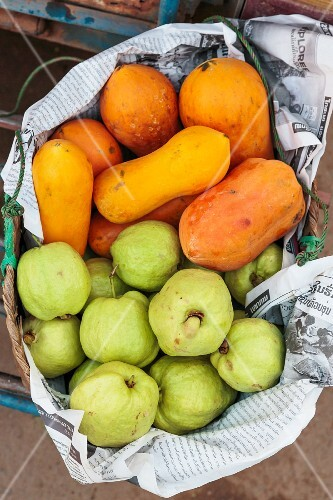 Papayas and guavas in a large basket