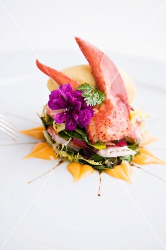 A lobster and melon sorbet on a herb salad